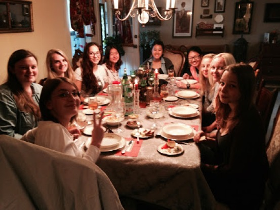 Exchange students gather for dinner.