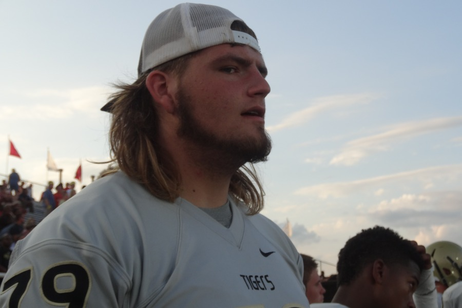 Rowdy Frederick brings laughter and height to the Tiger football team.
