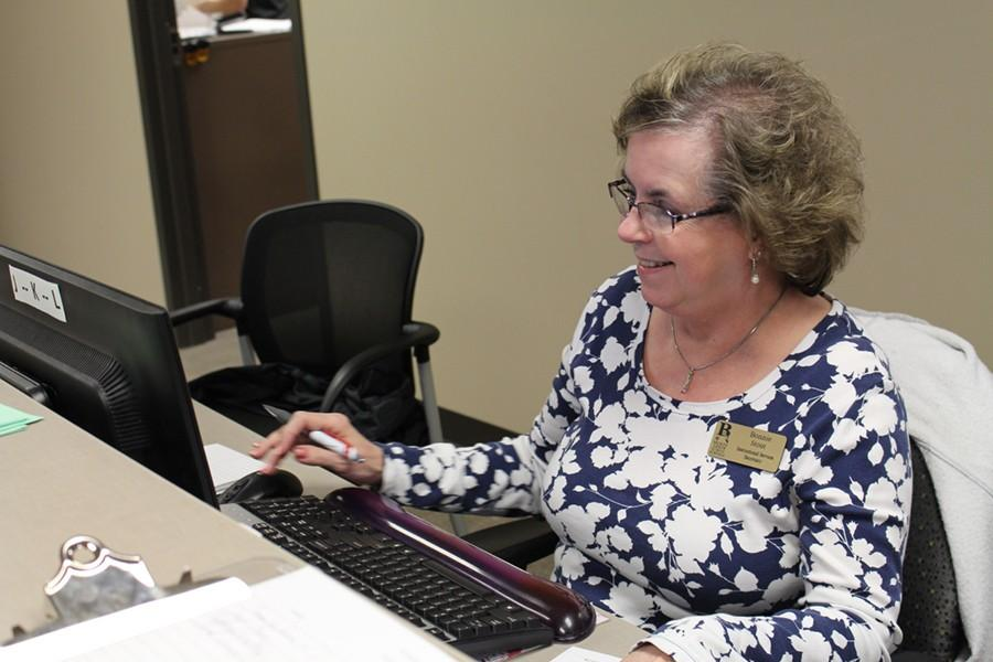 Ms.+Bonnie+Stout+performs+her+duties+as+an+administrative+assistant+in+the+A+building.