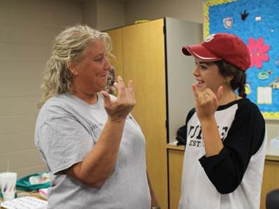 Sign language class leaves them speechless