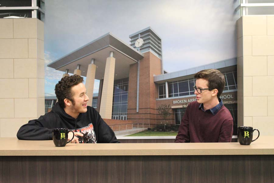 Seniors Tanner Cates and Jacob Hanna chat at the news desk.