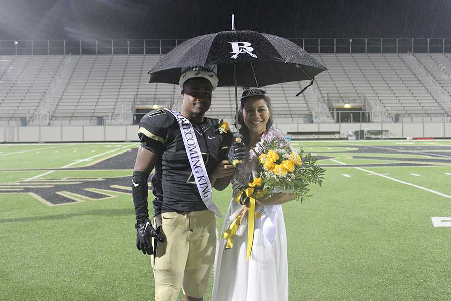 Homecoming Queen Spencer Tuia stands with Homecoming King Jamall Shaw just after being crowned.