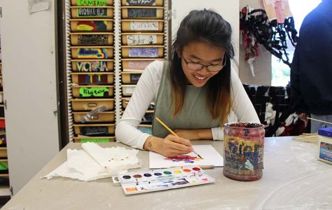 Senior Sonja Truong works on a watercolor piece in Mrs. Jennifer Deal's art class.