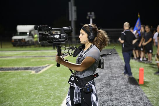 BAHS sophomore Jianna Giovanetti working the sideline camera at the game