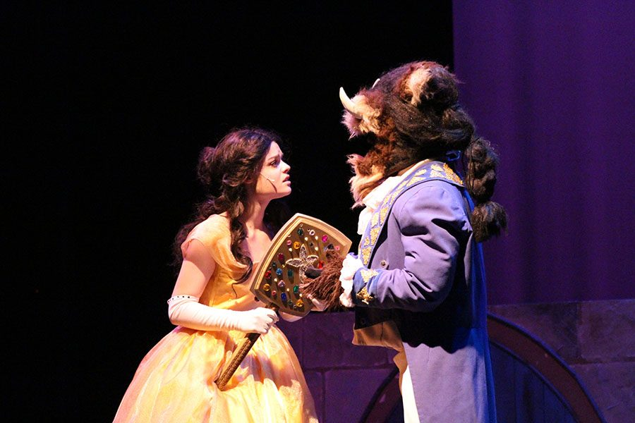 Beauty+and+the+Beast+share+a+moment+on+stage+