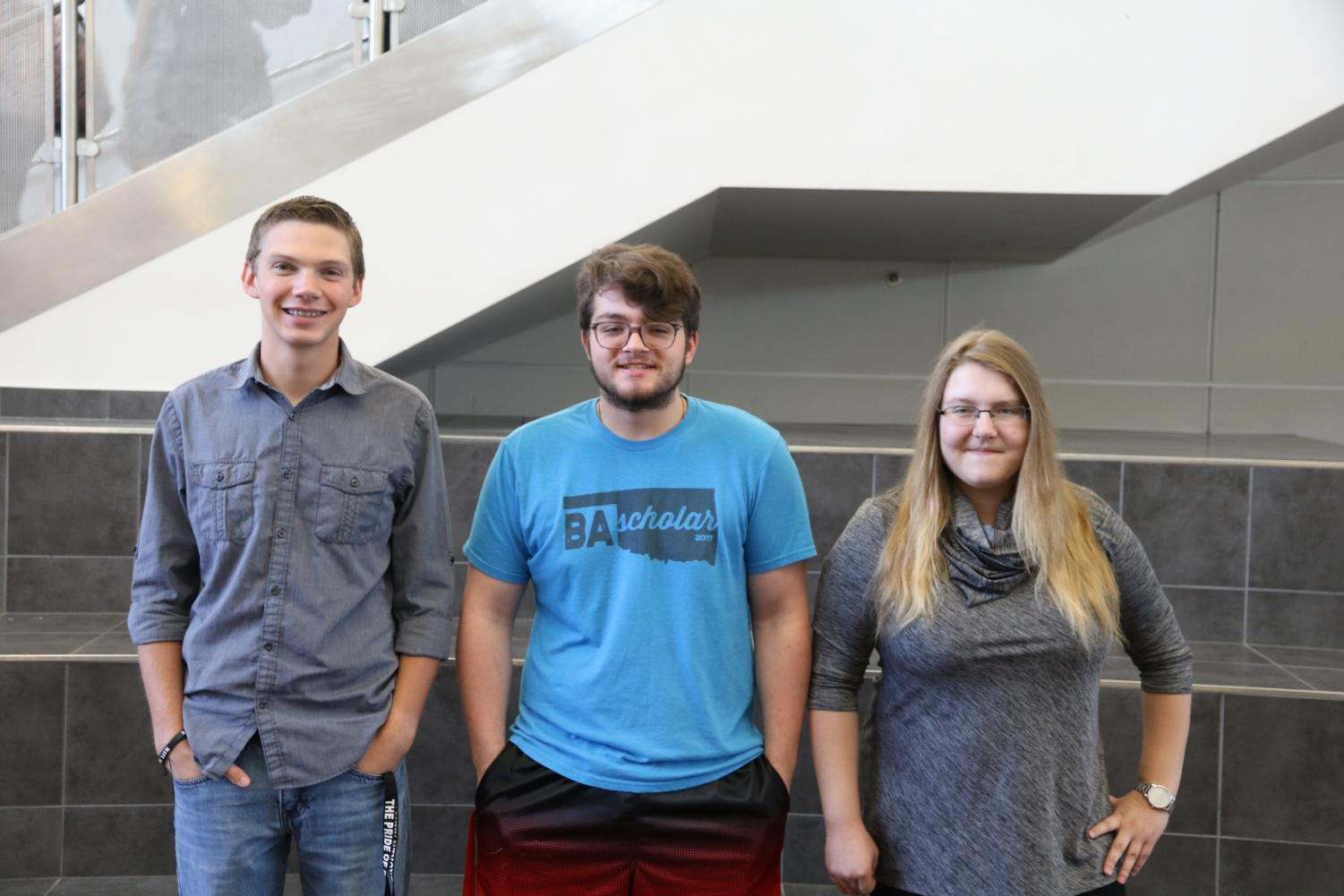 National Merit Semi-Finalists Jeremie Reese, Mason Simmons, and Gillian LeFevre pose for a photo.