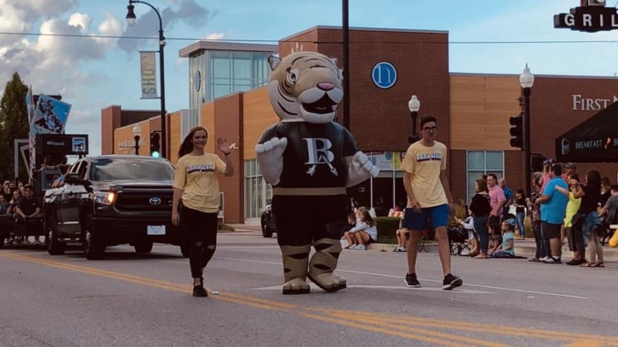 As+the+mascot%2C+senior+Samantha+Hough+participates+in+the+annual+Homecoming+Parade.