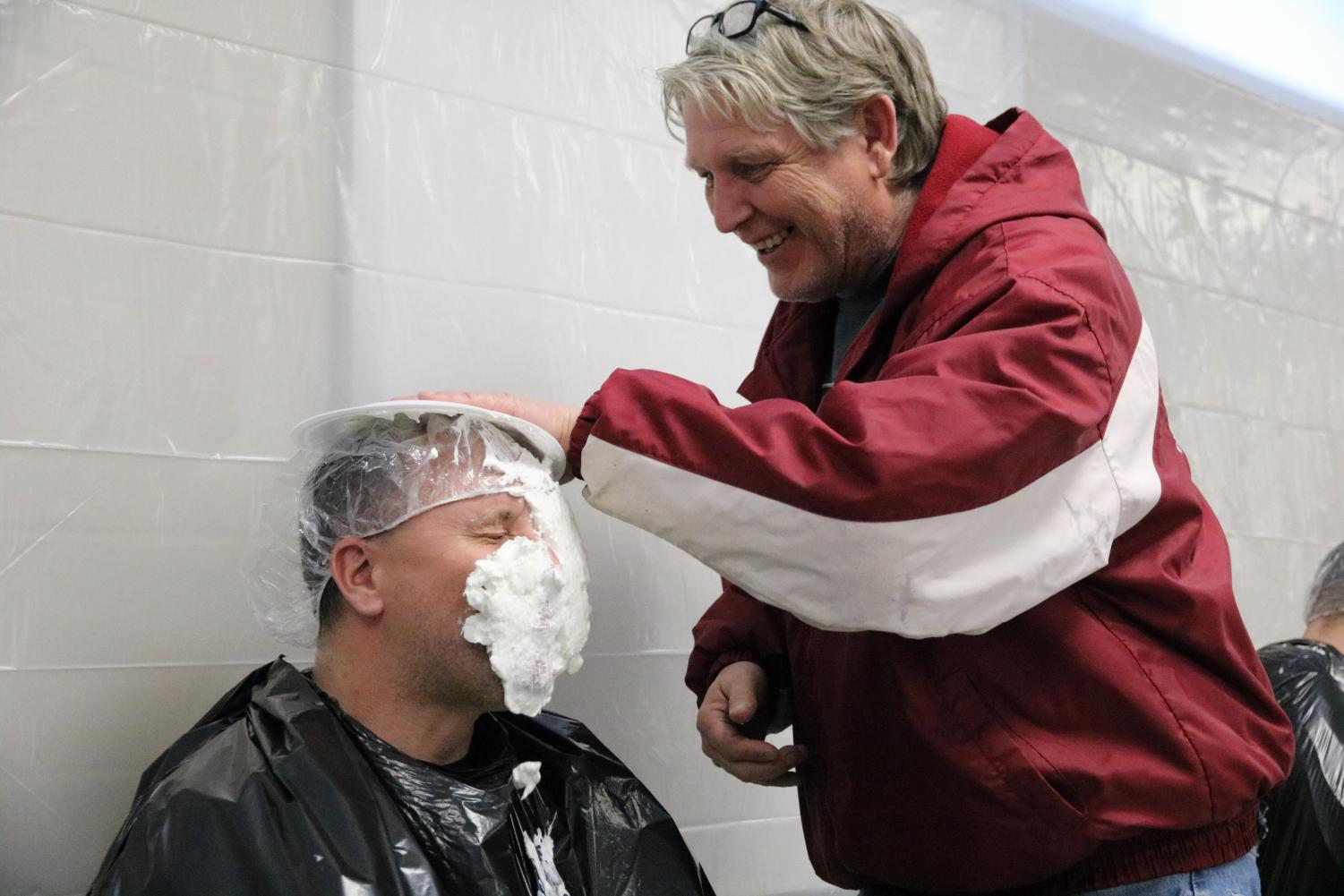 Teachers pie each other in the face during Smile Week to raise money for Make-A-Wish foundation.