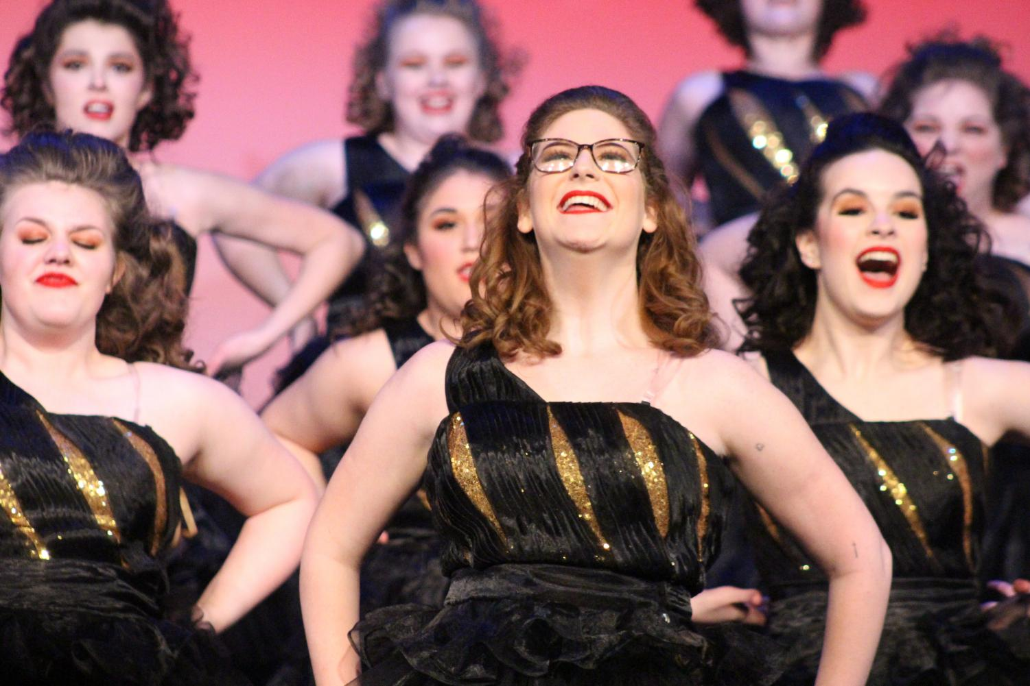 Senior Emily Shultz smiles while performing with Tiger Rhythm at the Broken Arrow Performing Arts Center.