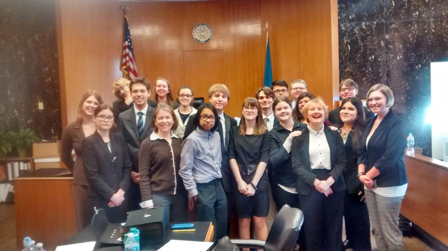 The 2018-2019 Mock Trial team poses for a photo in the courtroom.