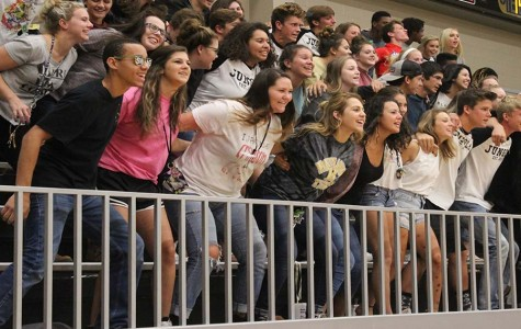The student section participates in a chant led by the Jungle Squad at a home volleyball game on September 22.