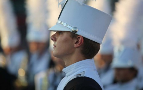 Senior Noah Fryer performs with The Pride.
