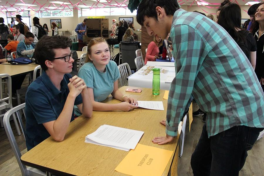 Thespian Club seniors Tanner Cates and Maddie Riggin talk to a potential member during Club Rush days.