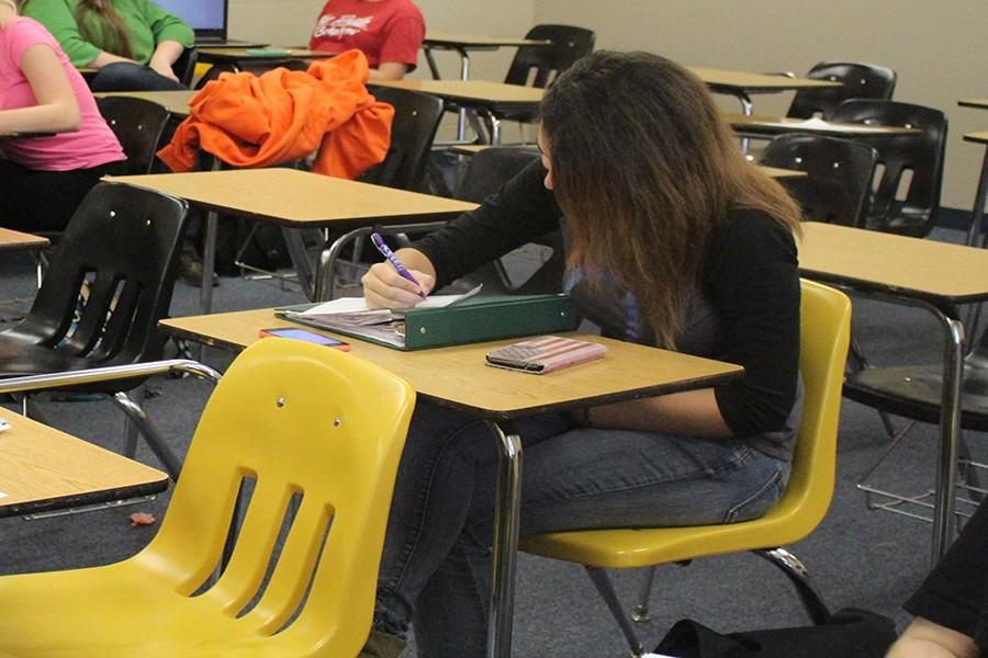 Junior Samantha Barbee works on her latest writing project in Joshua Wann's Creative Writing class.