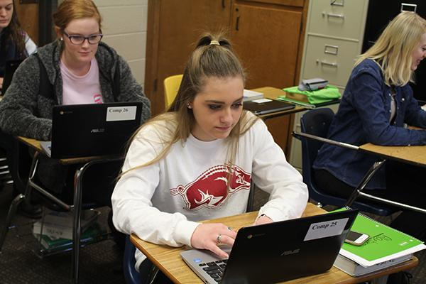 Senior Rachel Fulton does her class work on a Chromebook in her Algebra 3 class.