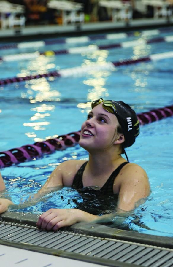 Swimmer Bailey Hill broke a school record with her relay team at the state swim meet.