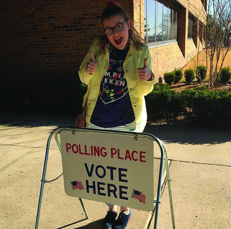 Senior Emily Doring poses for a photo before entering her polling place on Super Tuesday.
