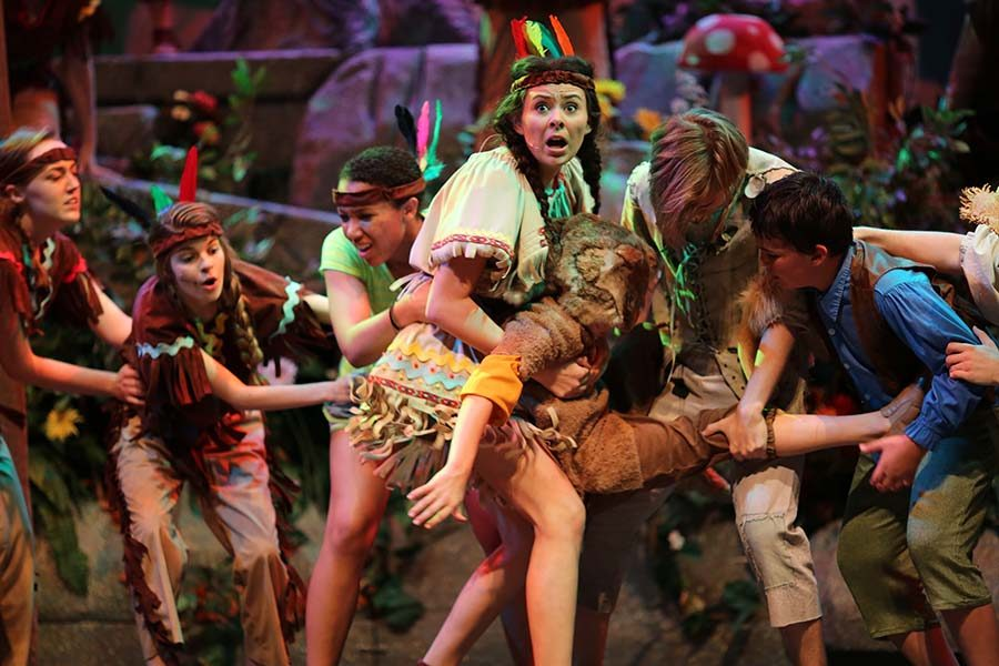 Senior Hailey Delano wrestles over Toodles with the lost boys as Tiger Lily.
