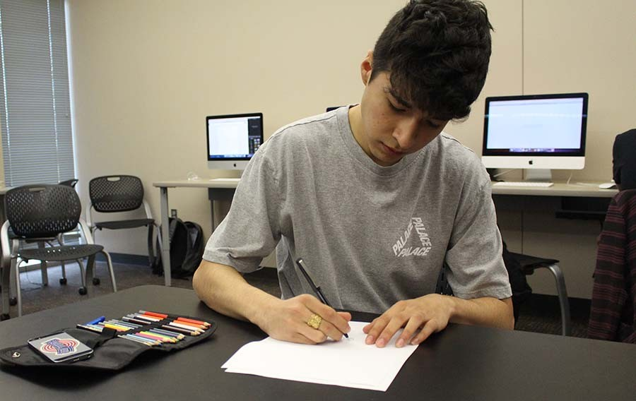 Senior Jesse Diaz works on a drawing during class.