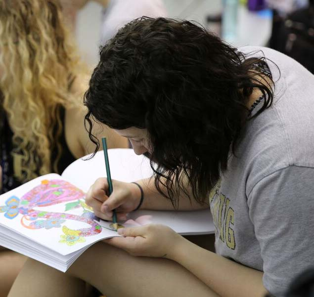 Senior Bailay Byrd takes a moment to color at the swim state championship earlier this year.