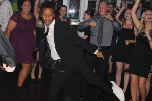 Sophomore Gabriel Jones dances in the middle of the floor at Homecoming.