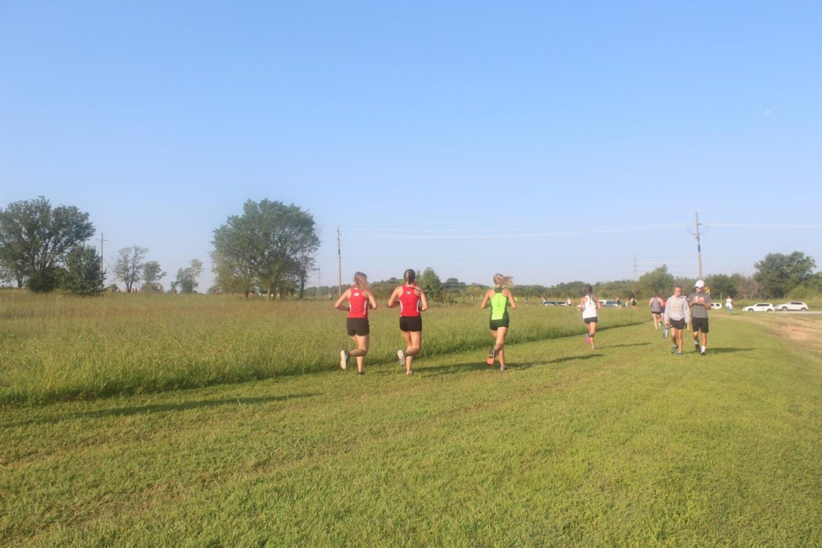 Cross Country runners racing for the finish line.