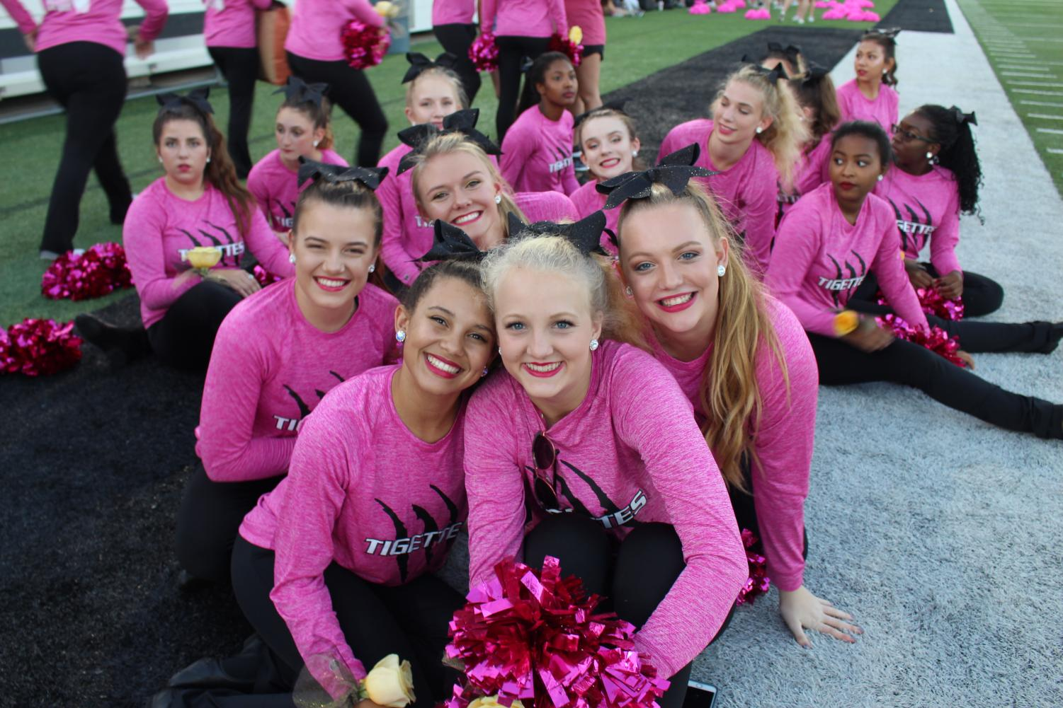 Tigettes gather on the sidelines during the half-time performances at the homecoming football game earlier in the year.
