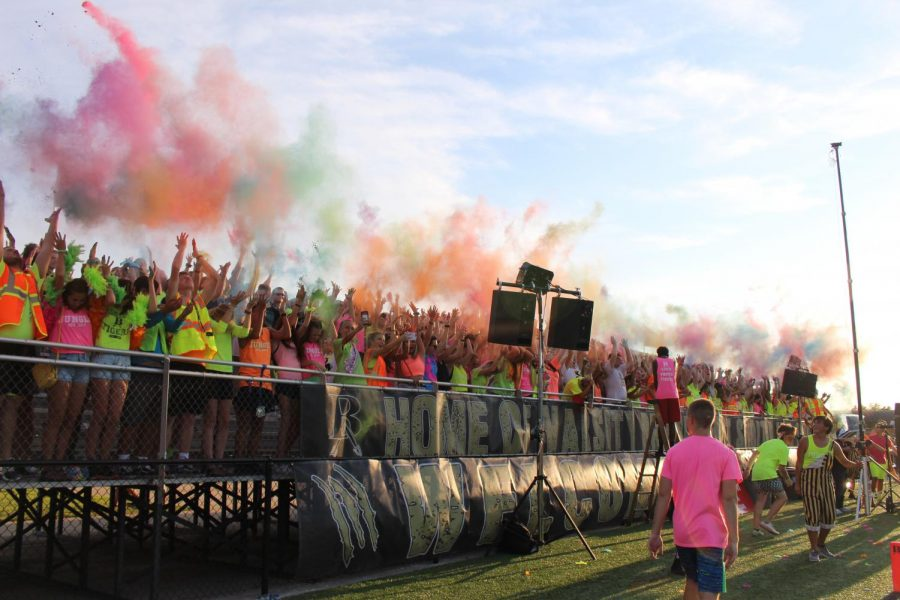 Students throw corn starch during the neon-themed game against Mansfield Aug. 31.