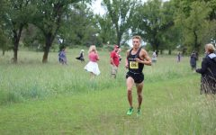 Cross country senior Blake McConkay runs through competition in first home meet