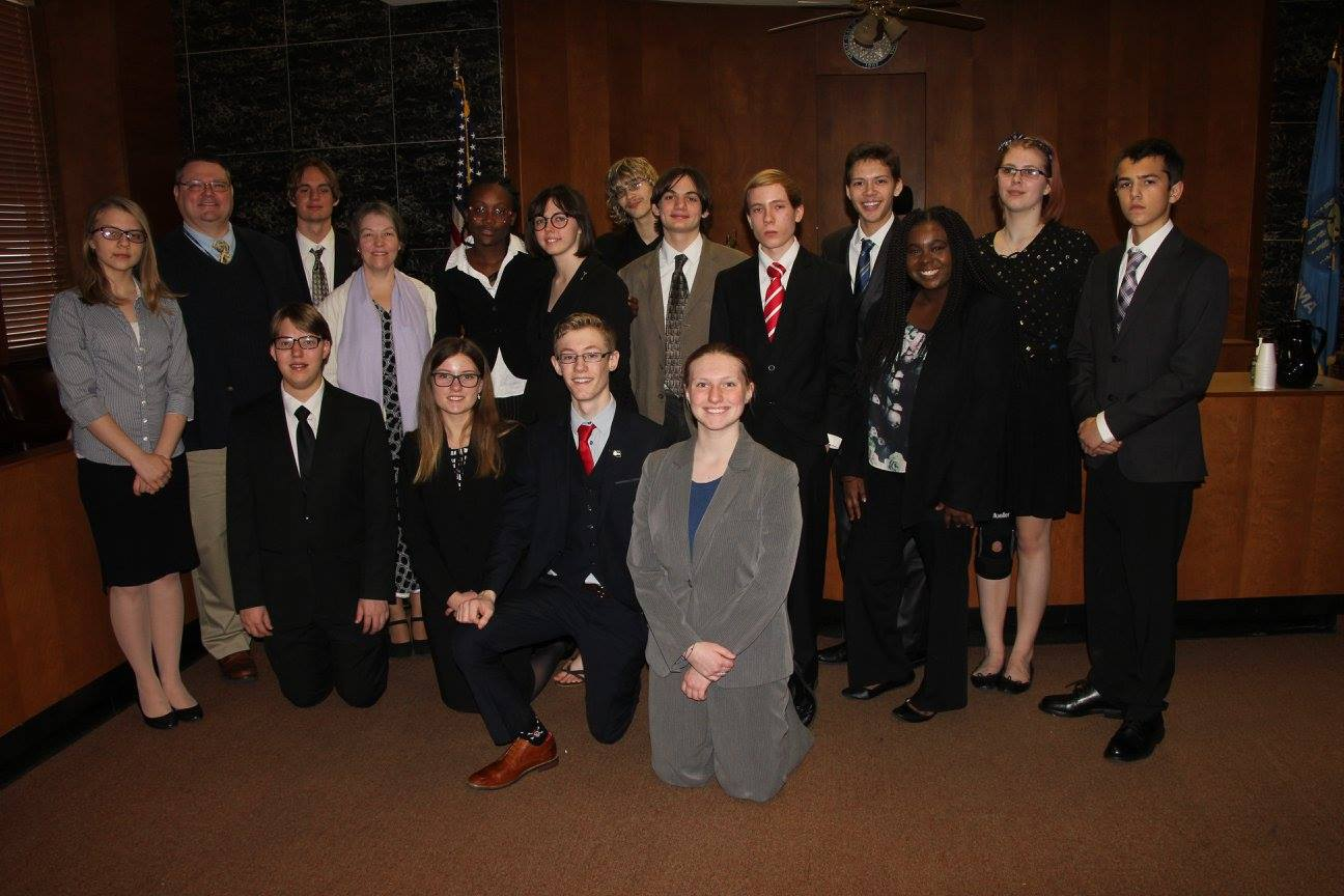 Mock Trial poses for a photo after participating in a contest.