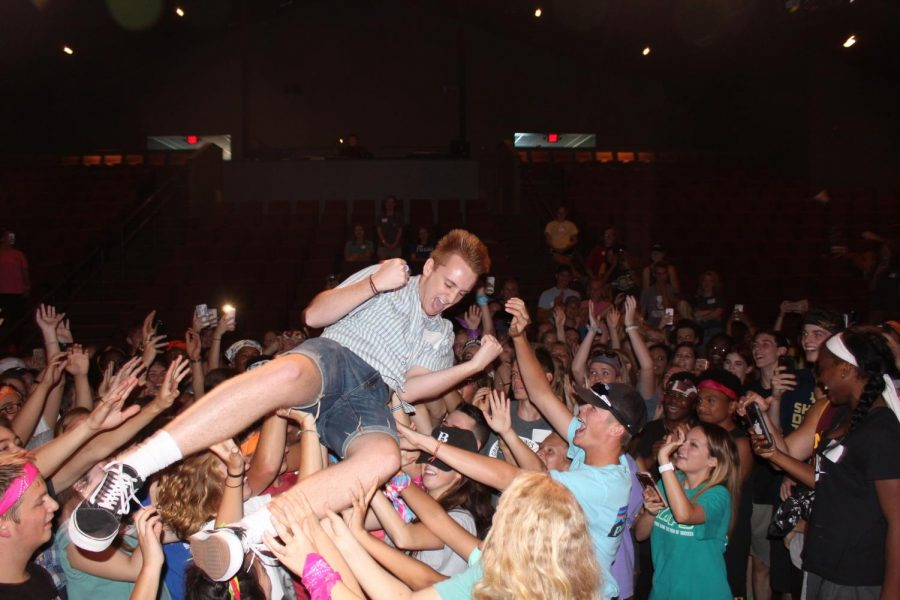 Sam Kiser crowd surfs at the 2017 Leadership Retreat in Dry Gulch.