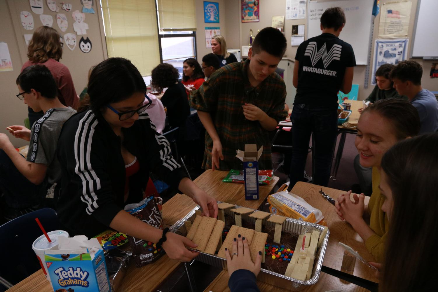 Latin students working on a food project in class