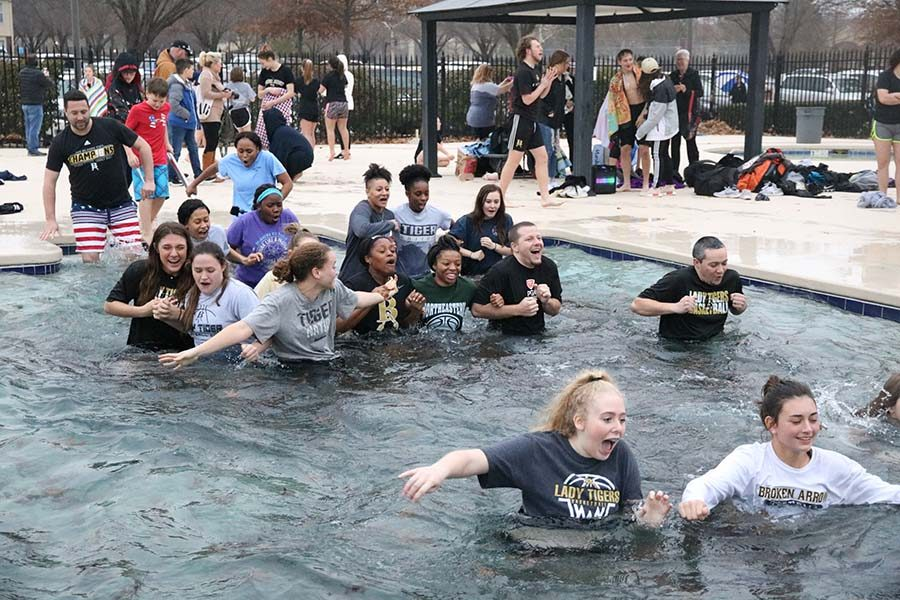 Broken Arrow students jump into freezing cold water to support the special olympics.