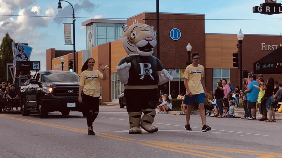 As the mascot, senior Samantha Hough participates in the annual Homecoming Parade.