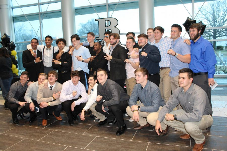 Senior+members+of+the+state+championship+football+team+pose+for+a+photo+after+receiving+their+state+rings+in+a+special+ceremony.+