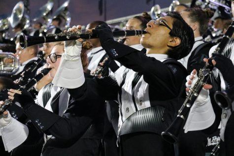 Clarinets often participate in a group dance while playing in the band stands.