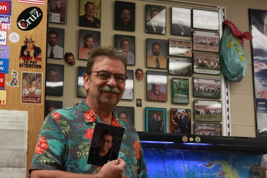 Stuart price has 19 school photos on display in his classroom.