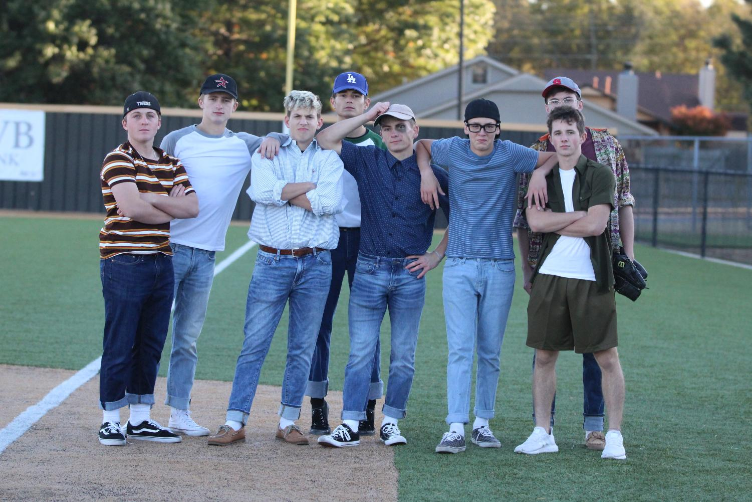 Dressed as the Sandlot crew, baseball players pose for a photo.
